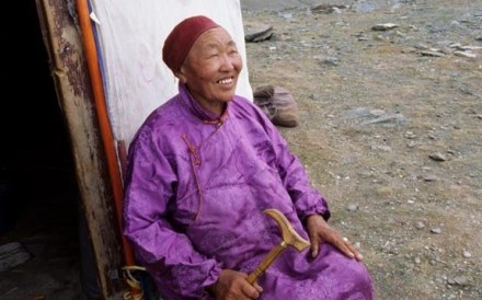 Mongolian Woman Outside Ger
